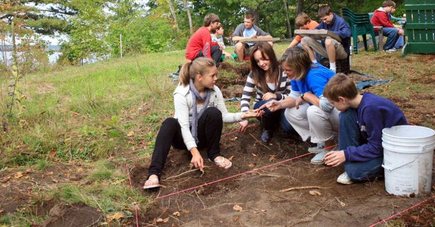 Chop Point School students participating in an archeological dig on campus